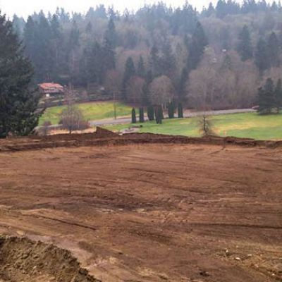 Kip Kalbrener and Mark Miller remodeling seventh green at Gig Harbor